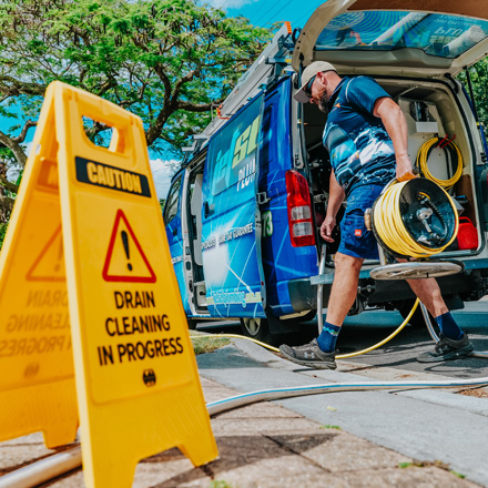 Plumbers Nerang clearing out a Blocked Drain